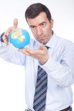 Man holding a globe on his hand Royalty Free Stock Photos