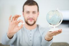 Man holding globe and pill. Man holding a globe and a pill Royalty Free Stock Photo