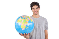 Man holding a globe Stock Photo