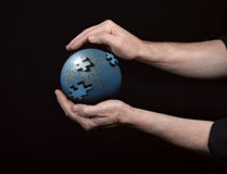 Man holding a glowing earth globe Stock Photo
