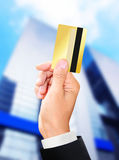 Man holding a gold card Stock Image