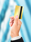 Man holding a gold credit card Royalty Free Stock Photo