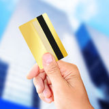 Man holding a gold credit card Royalty Free Stock Image