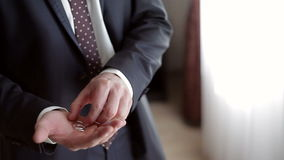 Man holding a gold rings in his hand stock footage