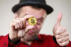 Man holding golden bitcoin royalty free stock photos