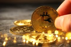 Man holding Golden Bitcoin over black background. Business concept. Royalty Free Stock Photos