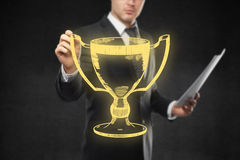 Man holding golden winner's cup sketch Stock Photo