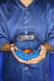 Man holding goldfish in bowl. Stock Images