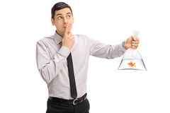 Man holding a goldfish and making a wish Stock Image