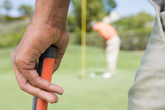 Man holding a golf club Royalty Free Stock Image