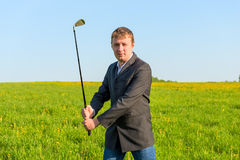 Man  holding a golf club Royalty Free Stock Photography