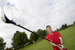 Man Holding Golf Club - Horizontal Stock Photo