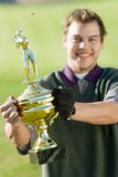 Man Holding Golf Trophy. Portrait of a cheerful middle aged men holding golf trophy Royalty Free Stock Images