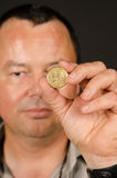 Man holding Greek drachma coin Royalty Free Stock Photo