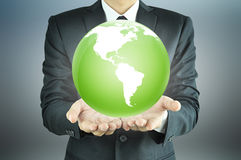 A man holding green globe Royalty Free Stock Photo