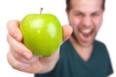 Man holding green organic apple stock image