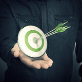 Man Holding Green Target - Marketing Solutions Concept Royalty Free Stock Images