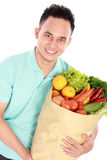 Man holding groceries Stock Images