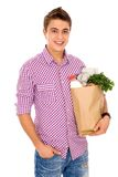 Man holding grocery bag Stock Image