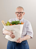 Man holding grocery bag of vegetables and fruits royalty free stock image