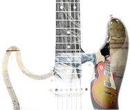 Man holding a guitar and guitar silhouette in double exposure. Back view of a man holding a guitar and guitar silhouette in double exposure Stock Images
