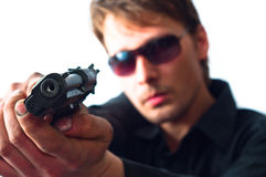 Man holding gun. With dirty hands with focus on pistol weraing sunglasses stock images