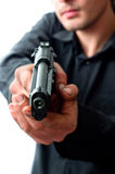 Man holding gun. With dirty hands with focus on pistol weraing sunglasses royalty free stock photography