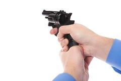 Man holding a gun Royalty Free Stock Images