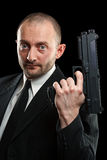 Man holding a gun Royalty Free Stock Images