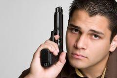 Man Holding Gun. Handsome hispanic man holding gun Royalty Free Stock Images