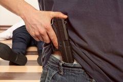Man holding gun Stock Images