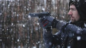 Man holding gun and aiming slow motion footage stock footage