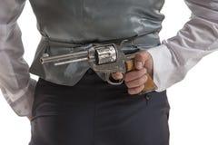 Man holding a gun behind his back Royalty Free Stock Photos