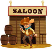 A man holding a gun in front of a saloon bar Royalty Free Stock Photography