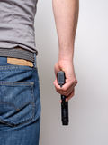 Man holding a gun in his hand ready to shoot Royalty Free Stock Photos