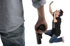Man  holding a gun. Man in a jeans holding a gun isolated on white Royalty Free Stock Photos