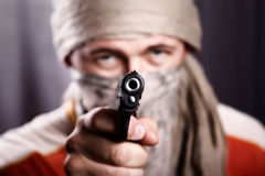Man holding a gun Stock Images