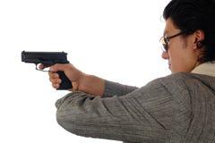 Man holding gun profile Stock Photo