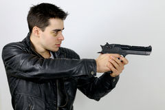 Man holding a gun. On a white background stock image