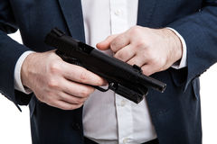 Man holding a gun Stock Photo