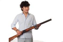 man holding gun on a white bg Royalty Free Stock Photography