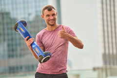 Man holding gyroboard, thumb up. royalty free stock photos