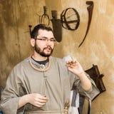 A man holding Half Shekel Coin Royalty Free Stock Image