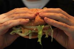 Man holding a hamburger Stock Photos