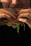 Man holding a hamburger Stock Photo