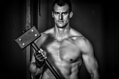 Man holding a hammer crossfit Royalty Free Stock Images
