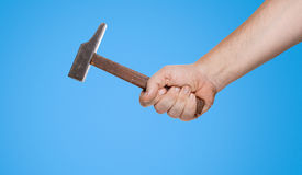 Man holding a hammer in his hand (clipping path) Royalty Free Stock Photography