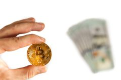 Man holding in hand a gold bar and coin Bitcoin on white background. Choice of investment, a new world order, exchange and sale. Man holding in hand Bitcoin on Royalty Free Stock Images