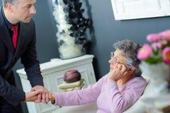 Man holding hand elderly woman Stock Image