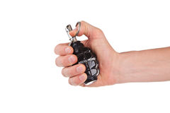 Man holding a hand grenade. On white background Stock Image